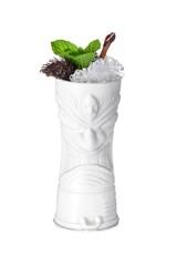 White tiki mug decorated with burning cinnamon stick, mint leaves, crushed ice and rambutan