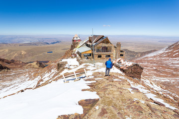 Mountain shelter hut building guesthouse, Chacaltaya ridge, Bolivia tourism traveling destination .