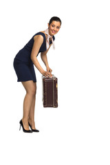 Beautiful young woman with an old suitcase. Merry, mischievous.