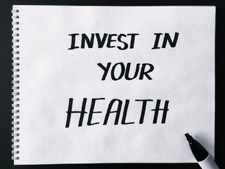 Invest in your health on white paper in black and white