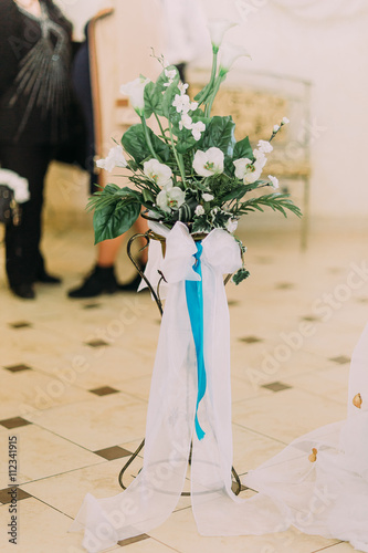 Beautiful Floral Wedding Decoration With Turquoise Ribbon On Black