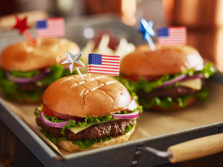 cheeseburgers with american flags for 4th of july picnic