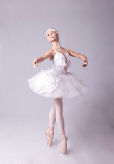 Ballerina  is dancing on a white background