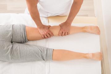 Therapist Giving Leg Massage