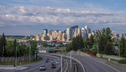 View of the Calgary skyline  in the evening with parkland in the foreground.