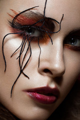 woman in the image of spider with creative art makeup. beauty face. Close up