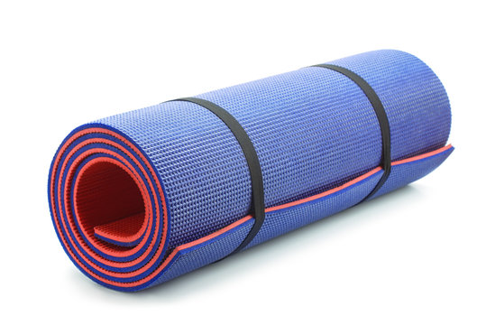 Rolled blue foam yoga mat