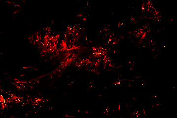 flying red  hot  sparks on a black background. the concept of risk of fires