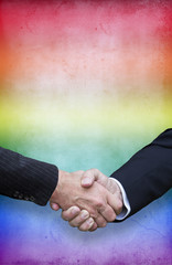 handshake with the rainbow colors for gay pride