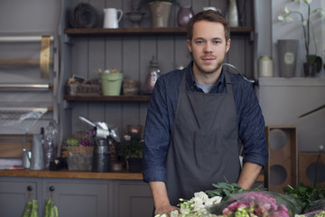 Portrait Of Male Florist At Work In Shop