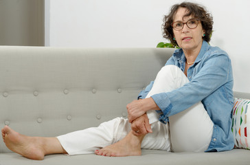 beautiful mature woman lying on the couch