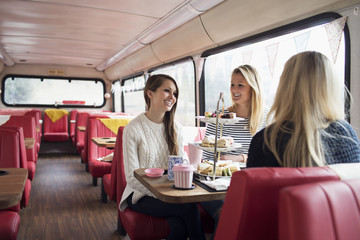Group Of Young Female Friends Meeting In Tea Bus
