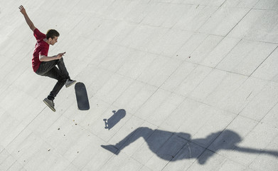 Teenager with a skateboard in the street