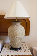 Table lamp next to a bed