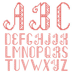 Vector cross stitch alphabet isolated on white background. The letters are embroidered with red thread.