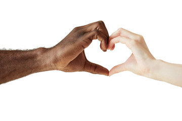 Two people of different races and ethnicities holding hands in the shape of a heart, symbolizing love, peace and unity. African man and Caucasian woman holding hands together. Interracial love concept