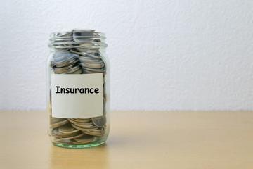 Money saving for Insurance in the glass bottle