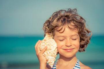 Child relaxing on the beach