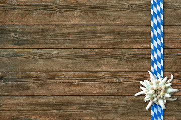 Oktoberfest background with edelweiss and Bavarian ribbon