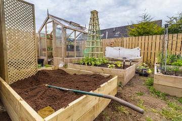 Wooden climbing trellis in vegetable garden or allotment