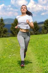 Pretty sporty woman jogging at park