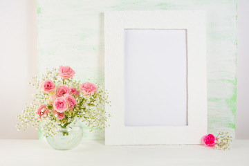 Frame mockup with roses in vase