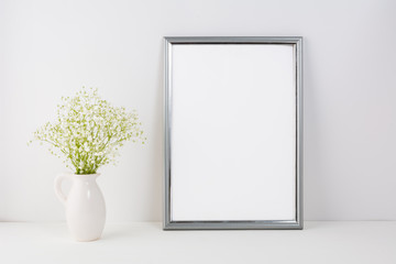 Frame mockup with white tender flowers