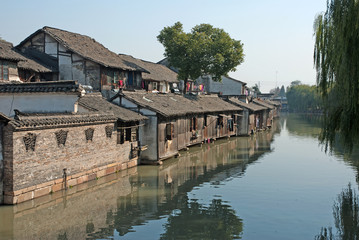 Shanghai, Wuzhen historic scenic town typical old houses reflection in a canal.