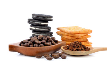 coffee beans, cookies and cracker on white