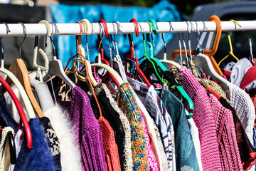colorful old fashioned women's sweaters at flea market