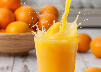 Orange juice pouring splash