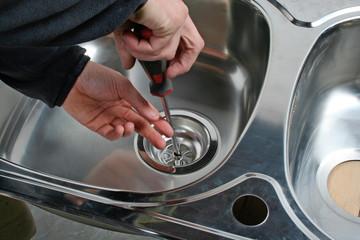 Plumber repairing kitchen sink