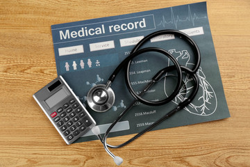 Medical concept. Medical record with  stethoscope on wooden background