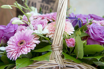 Beautiful bouquet of flowers with a pink gerberа. Focus in the center of the image, the image is slightly blurry edges