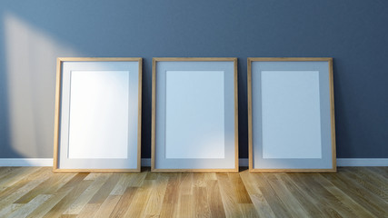 Three Blank picture frames standing on floor. Design Template for Mock Up. 3d render