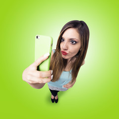 funny girl make a duck face, and take a self portrait with her s