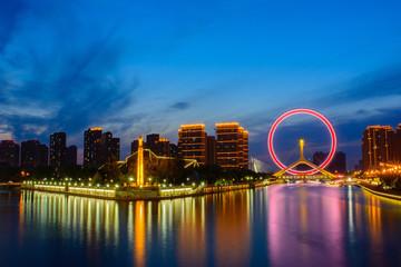 Night scene cityscape of Tianjin ferris wheel,Tianjin eyes  in t Papier Peint