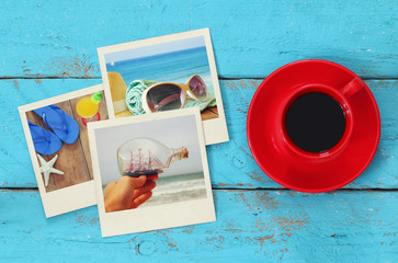 top view of travel instant photographs next to cup of coffee