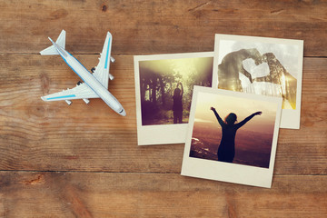 travel instant photographs next to airplane over wooden table