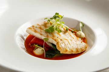 Grilled turbot, tabouli, sweet pepper sauce and summer vegetables. White dish