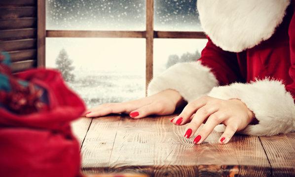 sack and santa claus woman