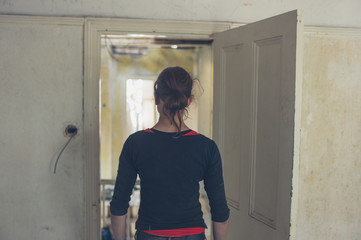 Woman standing by door in house being renovated
