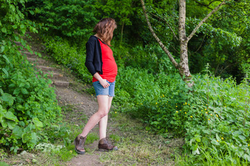 Young pregnant woman in the woods