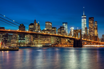 Manhattan with skyscrapers and  Brooklin Bridge by evening, New