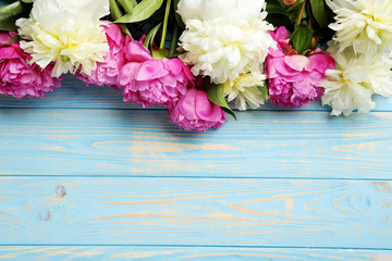 Bouquet of peony flowers on wooden table