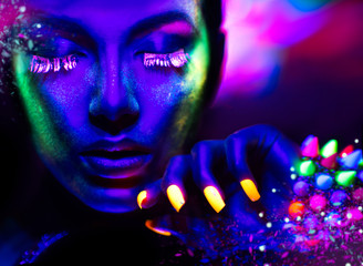 Wall Mural - Fashion woman in neon light, portrait of beauty model with fluorescent makeup