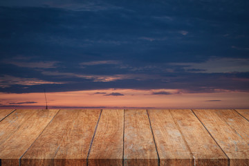 Perspective top wooden with sunrise beautiful sky