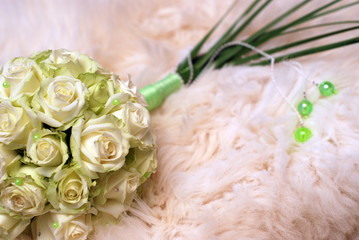 wedding bouquet and bedspread