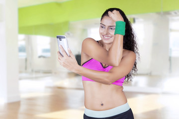 Fitness woman taking selfie photo at gym