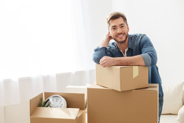 Smiling guy moving into his new home